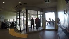Entrance and exit glass revolving door at a hospital Stock Footage