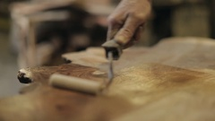 Oiling a Block of Natural Wood Stock Footage
