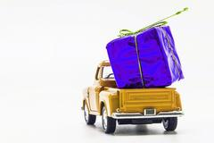 Yellow retro car pickup violet gift box isolated Stock Photos