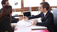 Couple Signs Purchase Agreement Stock Footage