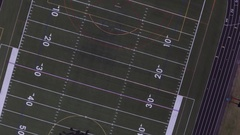 Aerial view of a high school track and football field - 4k Stock Footage