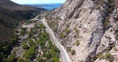 Road through mountains to sea at crete Greece Stock Footage