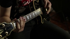 Guitarists of a rock band plays on guitar, close-up hands and guitar neck Stock Footage