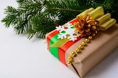 Kraft paper wrapping Christmas gift decorated with snowflake Stock Photos