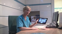 Dentist explaining procedure on x-ray, smiling to camera. Steadicam shot. Stock Footage