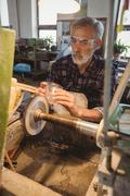 Glassblower polishing and grinding a glassware Stock Photos