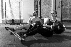 Pleasant good looking workout partners training together Kuvituskuvat
