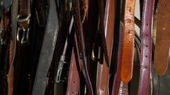 Lots of leather belts Stock Footage