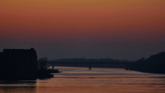 Sunset landscape of river with bridge on the horizon  Stock Footage