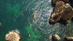 Aerial. Rise drone capture video kayaks in the bay Ponta de Piedade. Lagos. Stock Footage