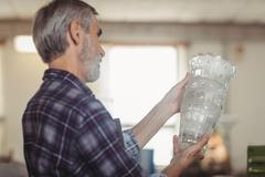 Glassblower examining glassware Stock Photos