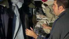 Messy closet clothing cleaning looking Stock Footage