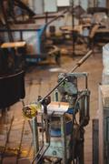 Molten glass on blowpipe on marver table Stock Photos