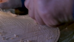 Lute maker planing wooden violin body Stock Footage
