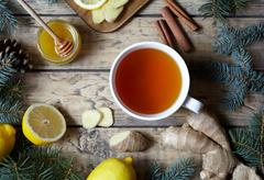 White cup of black natural tea with ginger, lemon and honey. Healthy drink. Hot Stock Photos