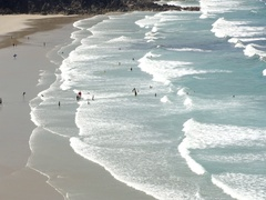 Surfers and bathers in Britain' beach Stock Footage