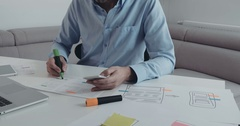 Closeup of webdesigner planning usability for mobile application Stock Footage