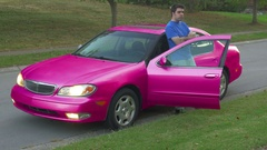 S2 pink car weird paintjob 1 Stock Footage