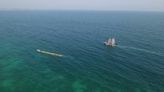 Aerial Kayaks and sailboat in the bay Ponta de Piedade. Lagos Algarve Stock Footage