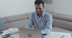 Handome businessman doing teleworking from home working on laptop Stock Footage