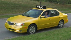 S2 waiting in taxicab taxi cab Stock Footage