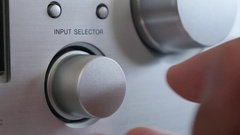 Silver finish Hi-Fi design amp changing sources close-up Stock Footage