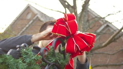 Tie ribbon outside christmas decoration tieing bow Stock Footage