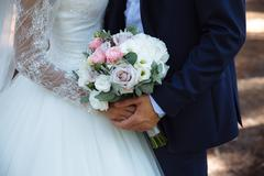 Wedding bouquet in marriage couple hands Stock Photos