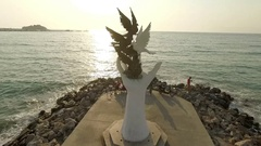 Sculpture against a blue sky on the promenade next to the Aegean sea Stock Footage