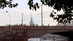 Moskva river and a Stalinist style skyscraper Stock Footage