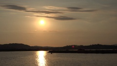4K Amazing sunset over water lake sun silhouette and orange sky light reflection Stock Footage