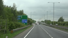 4K POV Point of view car cross busy freeway in cloudy day England infrastructure Stock Footage