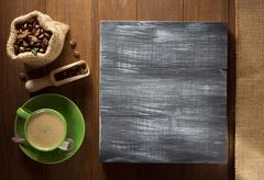 Coffee cup and  beans on wood Stock Photos
