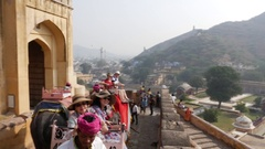 Elephants carrying passengers at Amber Fort in Jaipur, Rajasthan, India Stock Footage