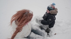 Mother and son having fun in the snow wonderful winter day Stock Footage