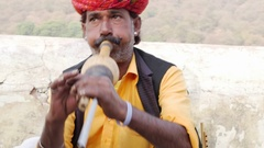 Snake charmer at the street of Jaipur, India Stock Footage