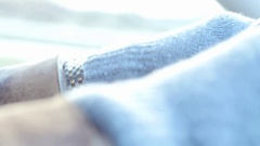 Hands in gloves on steering wheel close up in running car Stock Footage