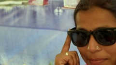 Cool beautiful woman in traditional clothes wearing and posing with sunglasses i Stock Footage