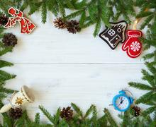 Christmas border with fir tree branches, christmas decorations and candy ca.. Stock Photos