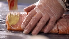 Slicing salmon. The cook prepares fish for frying. Fillet of a salmon. The cook Stock Footage