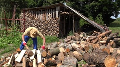 Worker prepare firewood for cold season. 4K Stock Footage