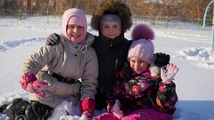 Happy children hugged each other and smile in the winter park Stock Footage