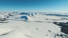 Aerial shot of mountains and fields by ski resort. Stock Footage