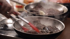 Close up. Close up on cook's hands . Male hands. The man rummages around meat on Stock Footage