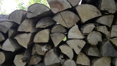 Pile of stacked firewood in rural garden ready for wintertime Stock Footage