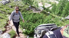 Young female hiker on a mountain trail. Stock Footage