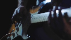 Musician plays heavy rock by electric guitar at the dark record studio close-up Stock Footage