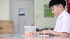 Asian cute boy with play plastic toys at school, Art hours. Stock Footage