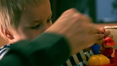 Little boy playing with colorful construction set. Father and his small kid Stock Footage
