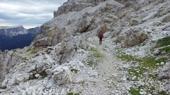 Young female hiker walks in Italian Dolomites. Stock Footage